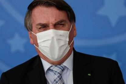 O presidente Jair Bolsonaro em evento no Palácio do Planalto no dia 11, quando usou a máscara, que costuma criticar.