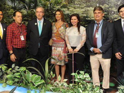 Cunha com a mulher, Claudia Cruz, ao lado, em evento da Câmara Itinerante no Amazonas, em junho.