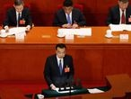 Chinese Premier Li Keqiang delivers a speech at the opening session of the National People's Congress (NPC) at the Great Hall of the People in Beijing, China May 22, 2020. REUTERS/Carlos Garcia Rawlins