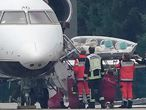 A stretcher is taken from special aircraft with the Kremlin critic Alexei Navalny on board at Tegel Airport in Berlin, Germany, Saturday, Aug. 22, 2020. The Russian opposition member has been in a coma since Thursday and is on artificial respiration has been flown to Germany to receive treatment. ( Michael Kappeler/dpa via AP)