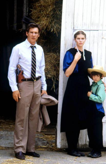 Com Harrison Ford e Lukas Haas em 'A Testemunha', seu primeiro grande papel, que lhe valeu críticas entusiasmadas em 1985.