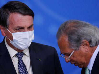 O presidente Jair Bolsonaro e o ministro da Economia, Paulo Guedes, em um evento em 9 de agosto em Brasília.