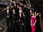 """Kwak Sin Ae and Bong Joon-ho win the Oscar for Best Picture for """"Parasite"""" at the 92nd Academy Awards in Hollywood, Los Angeles, California, U.S., February 9, 2020. REUTERS/Mario Anzuoni"""