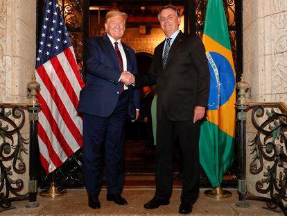 Trump cumprimenta Bolsonaro em encontro nos EUA.   07/03/2020 ONLY FOR USE IN SPAIN