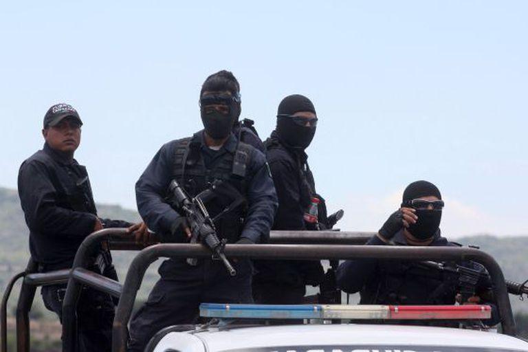 Policiais em Tanhuato.