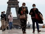 People wearing face masks walk at Trocadero square near the Eiffel Tower, as France began a gradual end to a nationwide lockdown due to the coronavirus disease (COVID-19) in Paris, France, May 16, 2020. REUTERS/Gonzalo Fuentes