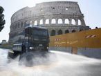 Rome (Italy), 04/04/2020.- To fight the Coronavirus Italian police use vehicles equipped with water cannons to clean the streets Rome at the Colosseum, Rome, Italy, 4 April 2020. Countries around the world are taking increased measures to stem the widespread of the SARS-CoV-2 coronavirus which causes the Covid-19 disease. (Italia, Roma) EFE/EPA/CLAUDIO PERI