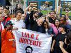 Former Brazilian President Luiz Inacio Lula da Silva walks out after being released from prison, in Curitiba
