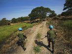 """(FILES) In this file photo taken on December 14, 2016 peacekeeper troops from Ethiopia and deployed in the UN Interim Security Force for Abyei (UNISFA) patrol outside Abyei town, in Abyei state. - The 193 member states of the United Nations have thus far failed to agree on a peacekeeping budget for the year beginning July 1, which could lead to """"a freeze on all missions"""" should a deal not soon materialize, diplomats said June 28, 2021. (Photo by ALBERT GONZALEZ FARRAN / AFP)"""