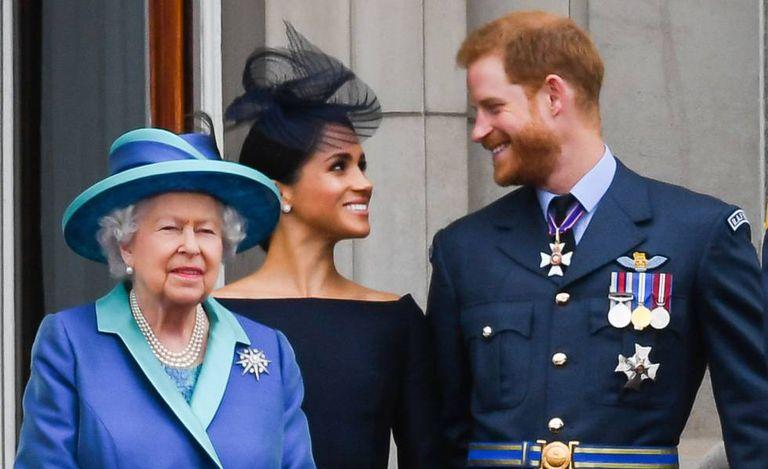 A rainha Elizabeth ||, Meghan Markle e o príncipe Harry, em julho do ano passado.