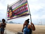 Protesters hold a banner depicting late activist and councilwoman Marielle Franco during a demonstration against Brazilian President Jair Bolsonaro and in support of democracy in Copacabana beach in Rio de Janeiro, Brazil June 7, 2020. REUTERS/Pilar Olivares