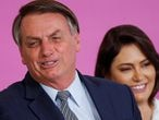Brazil's President Jair Bolsonaro reacts next to his wife Michelle Bolsonaro during a ceremony marking International Women's Day at Planalto Palace in Brasilia, Brazil March 6, 2020. Picture taken March 6, 2020. REUTERS/Adriano Machado