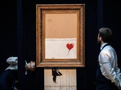 La obra de Banksy destruida tras ser subastada en Sotheby's.