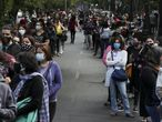 People line up for their turn to vote during a referendum to decide whether the country should replace its 40-year-old constitution, in Santiago, Chile, Sunday, Oct. 25, 2020.(AP Photo/Esteban Felix)