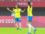 Brazil's midfielder Marta (L) celebrates after scoring her second goal, team's third, during the Tokyo 2020 Olympic Games women's group F first round football match between China and Brazil at the Miyagi Stadium in Miyagi on July 21, 2021. (Photo by Kohei CHIBAGARA / AFP)