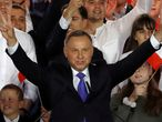 Polish President and presidential candidate of the Law and Justice (PiS) party Andrzej Duda gestures after the announcement of the first exit poll results on the second round of the presidential election in Pultusk, Poland, July 12, 2020. REUTERS/Kacper Pempel