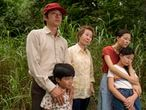 """cul 28.   This image released by A24 shows, from left, Steven Yeun, Alan S. Kim, Yuh-Jung Youn, Yeri Han, and Noel Cho in a scene from """"Minari."""" The film was nominated for a Golden Globe for best foreign language picture. (Josh Ethan Johnson/A24 via AP)"""