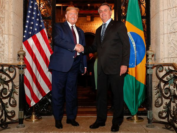 HANDOUT - 07 March 2020, US, West Palm Beach: US President Donald Trump (L) welcomes Brazilian President Jair Bolsonaro ahead of their meeting. Photo: Alan Santos/Palácio do Planalto/dpa - ATTENTION: editorial use only and only if the credit mentioned above is referenced in full   07/03/2020 ONLY FOR USE IN SPAIN