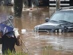 A man walk through a flooded street after heavy rains in Sao Paulo, Brazil, February 10, 2020. REUTERS/Rahel Patrasso