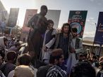 03-09-21 Central Asia - Afghanistan, capital city Kabul: A group of thieves are being publicly exhibited, the have been accused of terrorizing and robbing people at gun point, the Taliban has the evidence and confiscated the guns they used while committing the crimes. Juan Carlos