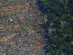 (FILES) In this file photo taken on August 23, 2019 Aerial picture showing a deforested piece of land in the Amazon rainforest near an area affected by fires, about 65 km from Porto Velho, in the state of Rondonia, in northern Brazil. - Deforestation in the Brazilian Amazon registered a semi-annual record of 3,070 km2 between January and June, 2020, according to official data that increases pressure on Brazilian President Jair Bolsonaro to abandon his projects of economic opening of the largest rainforest in the planet. (Photo by CARL DE SOUZA / AFP)