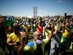 Supporters of far-right Brazilian President Jair Bolsonaro take part in a protest during a motorcade against the president of the Chamber of Deputies Rodrigo Maia, quarantine and social distancing measures, amid the coronavirus disease (COVID-19) outbreak, in Brasilia, Brazil May 3, 2020. REUTERS/Ueslei Marcelino