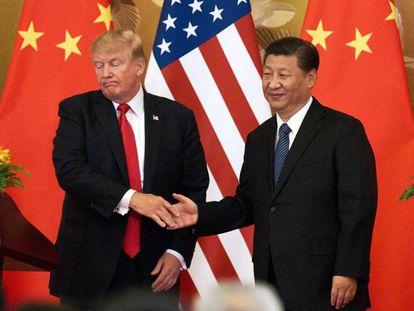 Donald Trump e Xi Jinping durante seu encontro em Pequim, em novembro passado.