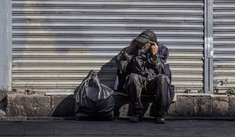 Um mendigo, no centro da Cidade do México.