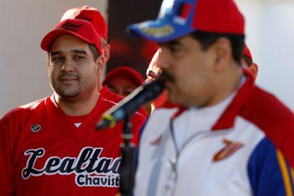 Nicolás Maduro Guerra, filho do presidente da Venezuela, Nicolás Maduro, observa o pai durante um discurso em Caracas, em 2018.