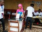 A woman casts her ballot at a polling station during the Guinea's presidential election in Conakry, Guinea October 18, 2020. REUTERS/Souleiman Camara  NO RESALES. NO ARCHIVES