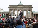 A member of the parliament Hansjoerg Mueller from AfD (Alternative fur Deutschland) speaks to demonstrators during a protest against the government's coronavirus disease (COVID-19) restrictions, in front of the Brandenburger Gate, in Berlin, November, 18, 2020. REUTERS/Christian Mang
