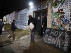 People receive gnocchis at the Santa Clara football club, transformed in a soup kitchen during the outbreak of the coronavirus disease (COVID-19), in Fuerte Apache, on the outskits of Buenos Aires, Argentina June 23, 2020. REUTERS/Agustin Marcarian