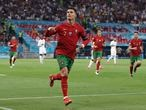 Portugal's Cristiano Ronaldo celebrates after scoring his side's second goal during the Euro 2020 soccer championship group F match between Portugal and France at the Puskas Arena in Budapest, Wednesday, June 23, 2021. (Bernadett Szabo, Pool photo via AP)