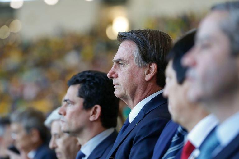 Presidente da República, Jair Bolsonaro, e o ministro da Justiça, Sergio Moro, durante a final da Copa América 2019.