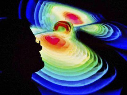 Cientista observa uma representação das ondas gravitacionais durante a apresentação da descoberta, em 11 de fevereiro