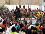 A crowd of people cheer Malian army soldiers at the Independence Square after a mutiny, in Bamako, Mali August 18, 2020. Picture taken August 18, 2020. REUTERS/Moussa Kalapo