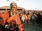 (FILES) This file photo taken on September 11, 2004, shows Zulu Queen Mantfombi Dlamini Zulu taking part in the annual Umkhosi woMhlanga (Reed Dance) dance festival at the Enyokeni Royal Palace in Kwa-Nongoma some 350 kilometres north of Durban. - Queen Shiyiwe Mantfombi Dlamini Zulu, the regent of the Zulu nation and senior wife of South Africa's recently deceased Zulu King Goodwill Zwelithini, died unexpectedly on April 29, 2021, the royal palace announced. The sudden death of Dlamini-Zulu, 65, comes days after she was reportedly hospitalised just weeks after her husband's burial. (Photo by RAJESH JANTILAL / AFP)
