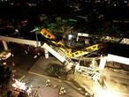 A general view of damage caused after a railway overpass and train collapsed onto a busy road in this drone picture obtained from social media Mexico City, Mexico May 4, 2021. Picture taken with a drone. INSTAGRAM @CSDRONES/via REUTERS   THIS IMAGE HAS BEEN SUPPLIED BY A THIRD PARTY. MANDATORY CREDIT.