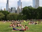 People enjoy socializing without masks in Central Park in the Manhattan borough of New York City, U.S., May 23, 2021. REUTERS/Caitlin Ochs