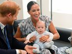 Britain's Prince Harry and his wife Meghan, Duchess of Sussex, holding their son Archie, meet Archbishop Desmond Tutu (not pictured) at the Desmond & Leah Tutu Legacy Foundation in Cape Town, South Africa, September 25, 2019.