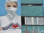 A mural depicting a healthcare worker is seen painted on a wall of the City Emergency Hospital, amid the coronavirus disease (COVID-19) outbreak in Lviv, Ukraine June 21, 2020. REUTERS/Pavlo Palamarchuk NO RESALES. NO ARCHIVES
