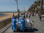 BARCELONA, SPAIN - JUNE 03: Hospital patient Isidre Correa is taken to the seaside by intensive heath care staff outside the Hospital del Mar on June 03, 2020 in Barcelona, Spain. Mr Correa was taken into Intensive Care on April 14 after his coronavirus infection worsened while he had been in hospital since April 9. Today he will leave the ICU to follow his recovery at the hospital. Hospital del Mar is taking recovering COVID-19 patients from the ICU to the seaside as part of their recovering process aiming to humanize its Intensive Care Units. (Photo by David Ramos/Getty Images)