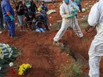 Relatives react during the burial of Geraldo Magalhaes, who died from the coronavirus disease (COVID-19), at Vila Formosa cemetery, Brazil's biggest cemetery, in Sao Paulo, Brazil, May 22, 2020. REUTERS/Amanda Perobelli     TPX IMAGES OF THE DAY