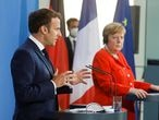 18 June 2021, Berlin: German Chancellor Angela Merkel (R) and French President Emmanuel Macron give a joint statement to journalists. Photo: Axel Schmidt/Reuters-Pool/dpa 18/06/2021 ONLY FOR USE IN SPAIN