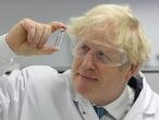 FILED - 30 November 2020, Wales, Wrexham: UK Prime Minister Boris Johnson holds up a vile of the Oxford/AstraZeneca Covid vaccine on a visit to the global pharmaceutical and biotech company Wockhardt. Photo: Andrew Parsons/No 10 Downing Street/dpa - ATTENTION: editorial use only and only if the credit mentioned above is referenced in full