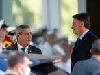 Brazil's President Jair Bolsonaro and Brazil's Defense Minister Walter Souza Braga Netto speak after a meeting in Brasilia, Brazil July 22, 2021. REUTERS/Adriano Machado
