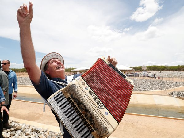 Brazil's President Jair Bolsonaro plays an accordion during a visit to works on water infrastructure in Sertania, Pernambuco state, Brazil, February 19, 2021. Alan Santos/Brazilian Presidency/Handout via REUTERS  THIS IMAGE HAS BEEN SUPPLIED BY A THIRD PARTY. MANDATORY CREDIT