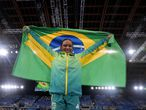 Rebeca Andrade of Brazil, celebrates after winning the gold medal on the vault during the artistic gymnastics women's apparatus final at the 2020 Summer Olympics, Sunday, Aug. 1, 2021, in Tokyo, Japan. (AP Photo/Natacha Pisarenko)