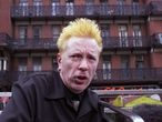 NEW YORK, NY - [October 2000]: John Lydon aka Johnny Lydon of the Sex Pistols and Public Image Limited holds tribute to the memory of former Sex Pistol bass player, Sid Vicious in front of The Chelsea Hotel where Sid died. This took place in October 2000 in New York City. (Photo by Bill Tompkins/Getty Images)