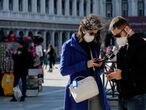 FILE PHOTO: Tourists wear protective masks in Saint Mark's Square in Venice as Italy battles a coronavirus outbreak, Venice, Italy, February 27, 2020. REUTERS/Manuel Silvestri/File Photo